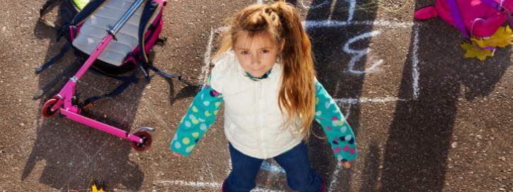 Girl jump on hopscotch