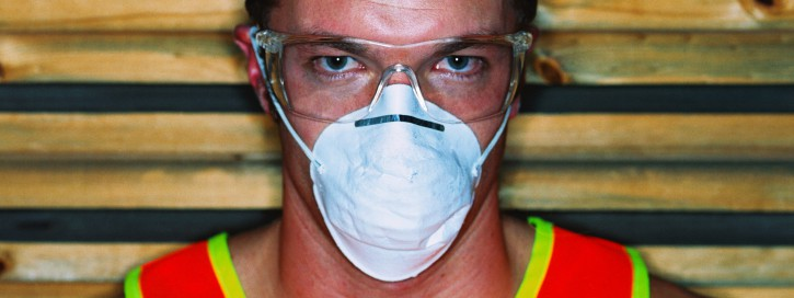 close-up of a man wearing a face mask and protective goggles