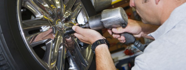 Mechanic Putting Tire on a Car