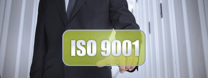 Businessman selecting a green label with iso 9001