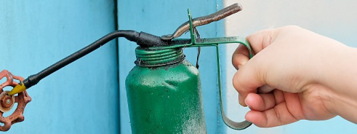 Hand Holding Old Vintage Green Oil Can