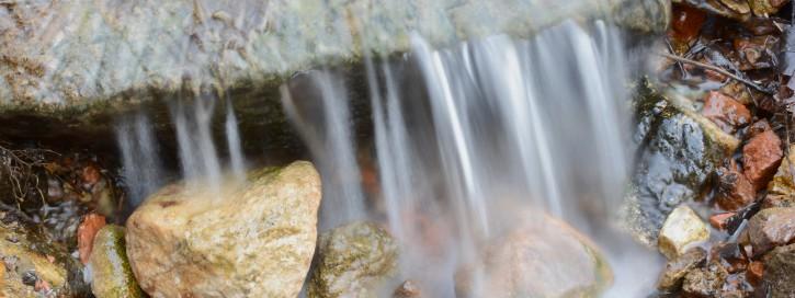 Water flowing over rocks in a blur effect