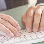 Digitalisierung, Hände an Tastatur